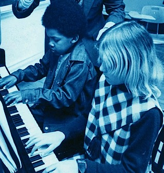 Two children at piano